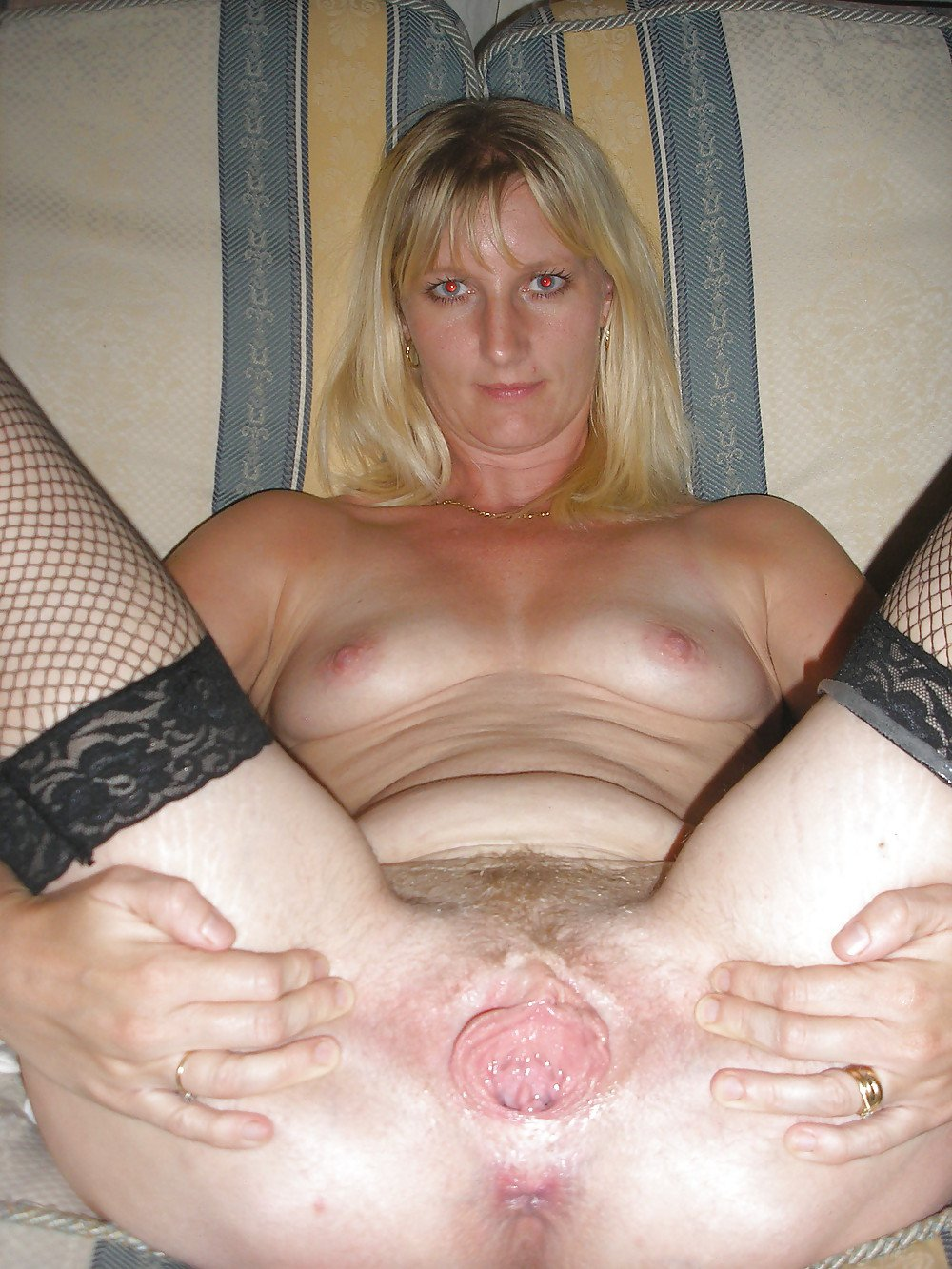 Mature open wide pussy Mature woman reveals her hairy pussy